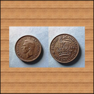 COIN OF ENGLAND... KING GEORGE VI .... ONE SHILLING .. IN THE YEAR 1942